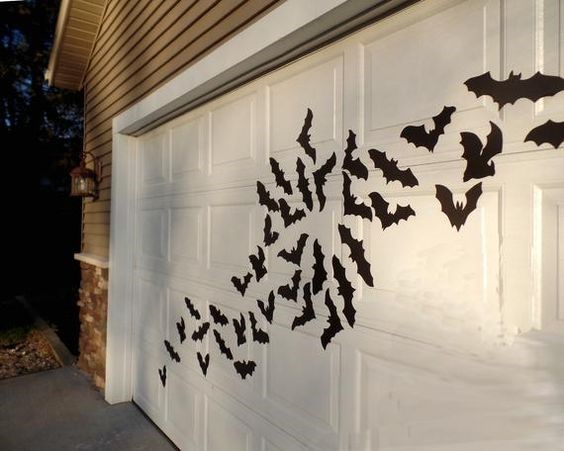 Bats flying across a garage door