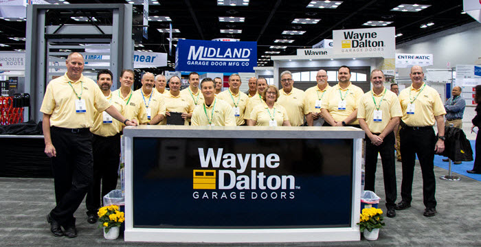 Wayne Dalton representatives in front of a Model 8450 Luminous® Door