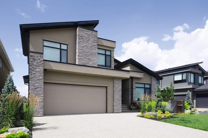 modern design home with garage door