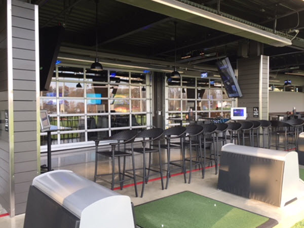glass garage door installed at Top Golf